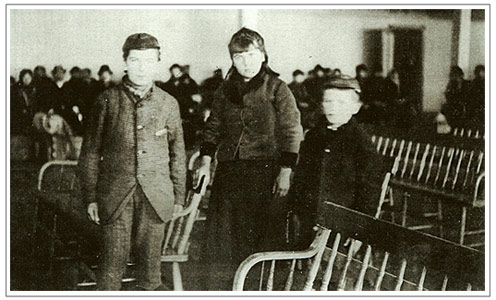 Annie Moore and her brothers Philip and Anthony arriving at Ellis Island